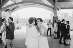 couple holding each other dancing at their lesbian michigan wedding