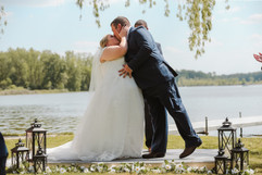 couples first kiss at their michigan wedding ceremony