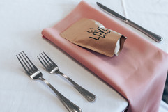 """pink and white table decor with a bag of coffee as a favor that says """"let love brew"""""""