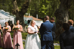 bride reading her vows at her wedding ceremony in michigan