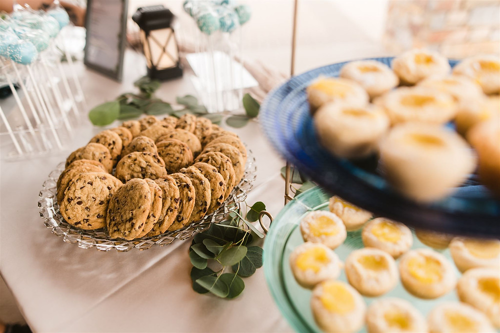 A wedding dessert display with cookies and tarts