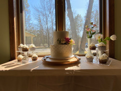 dessert display at kelsea and freddy's michigan church wedding. supplied by pops by patti a local michigan wedding baker and