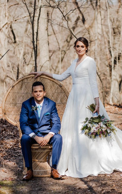 gorgeous michigan couple posing for portraits at their michigan wedding near the woods