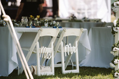 """couples chairs """"mr and mrs chair signs"""" at their head table"""