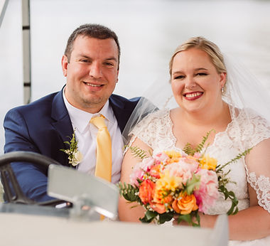 couple in a boat at an outdoor lakefront michigan wedding