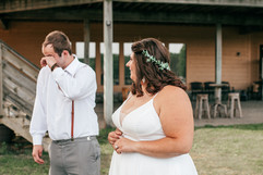 couples first look photo of the groom crying when he sees her for the first time
