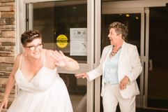 brides coming out of their hotel to go to the wedding
