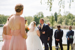 couple exchanging vows at their lakeside wedding ceremony