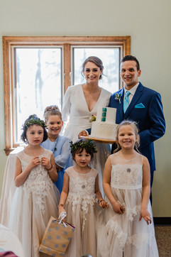 family photo of bride and groom at their michigan wedding