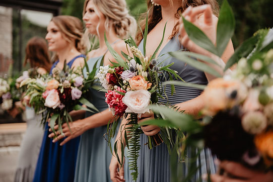 red, pink and blue bridesmaids bouquets at outdoor michigan wedding