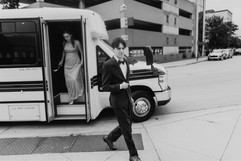 groomsmen getting off the party bus