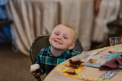 Little kid smiling at a michigan wedding reception planned by muse wedding, a local full service wedding planner and wedding coordinator