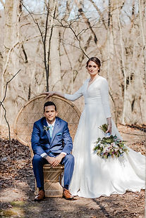 Spring michigan wedding. Couple posing in the woods, they had wedding management or wedding coordination