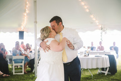 couple kissing at their first dance
