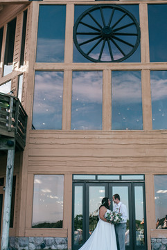 gorgeous michigan wedding couple posing in front of their wedding venue the double jj resort in rothbury michigan