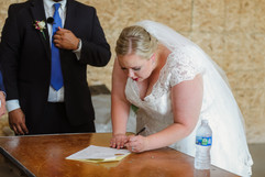 lexie the bride signing her marriage license at her outdoor michigan wedding