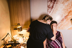 bride getting her makeup done at the springhill suites west in grand rapids michigan by style me pretty an onsite traveling makeup artist