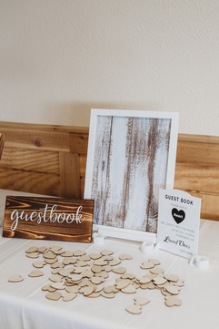 etsy style wooden heart sign guest book. Guests sign the wooden heart and drop it in the frame as keepsakes. It can then be hung up in the home after the wedding
