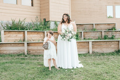 felicia and her daughter, the bride and flower girl posing with the bridal bouquet and the flower girl bucket!