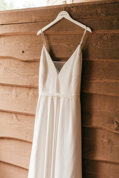 bride dress hanging on deck of getting ready suite at the double jj resort in rothbury michigan