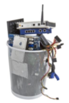 electronic scrap in trash can. keyboard,