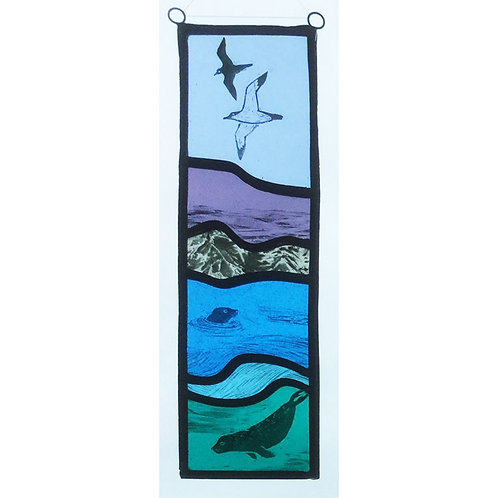 Stained glass hanger with seals and seabirds