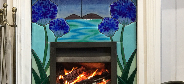 Fused glass tiles for fireplace.