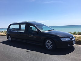 Mornington Peninsula Funerals hearse at Safety beach