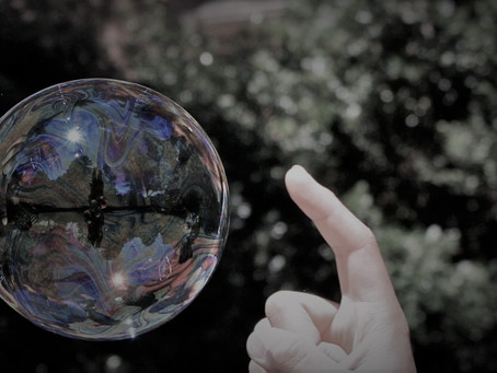 Bursting Bubbles: Why we can stop division through self-reflection