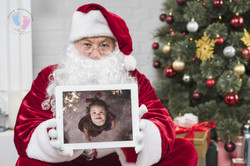 santa-claus-red-hat-holding-tablet-hands