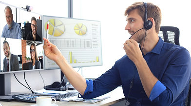 Businessman speak talk on video call with colleagues on online briefing during self isolat