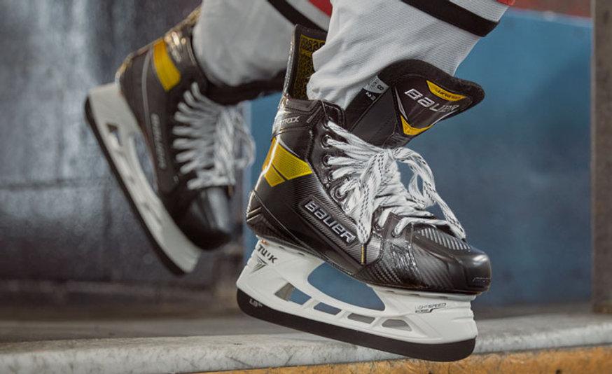 Skate-Sharpening-Bauer-Supreme-Skates-On-Ice.jpeg