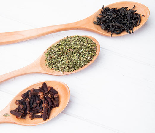 side-view-wood-spoons-with-spices-herbs-