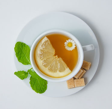 top-view-a-cup-of-chamomile-tea-with-lem
