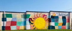 Here Comes The Sun Over Durant Mural
