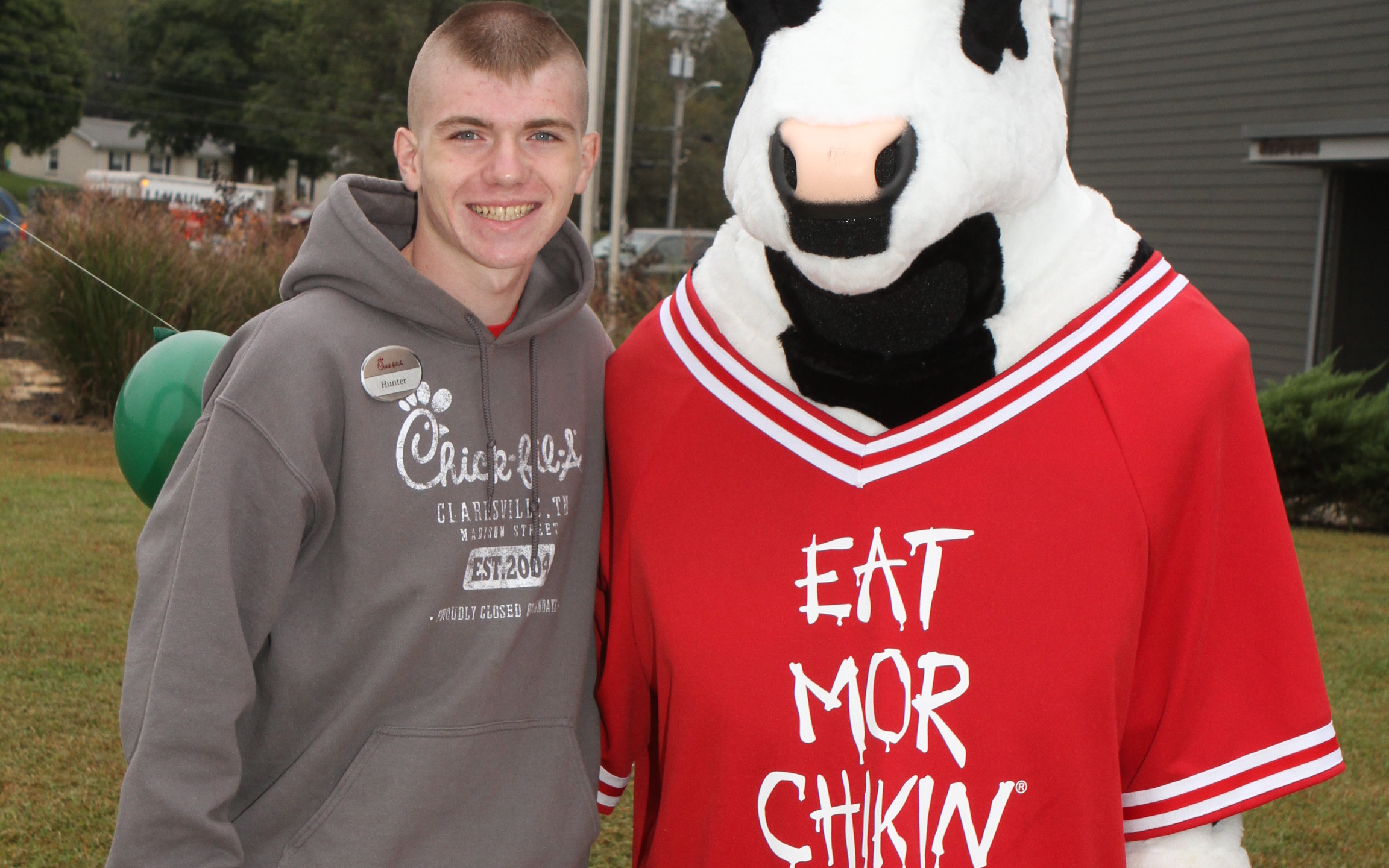 Hunter Lynch with the Chick-fil-A cow