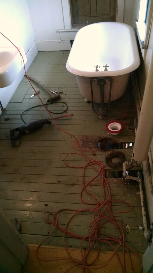 Old bathroom in apartment area gets reworked.