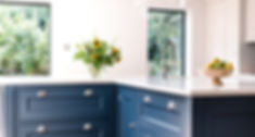 Dark blue island with white worktop