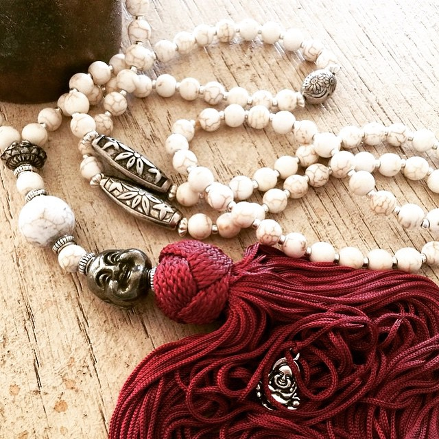 Howlite is a stone of awareness and a tiny Buddha is hidden within the strands of the tassel  as thi