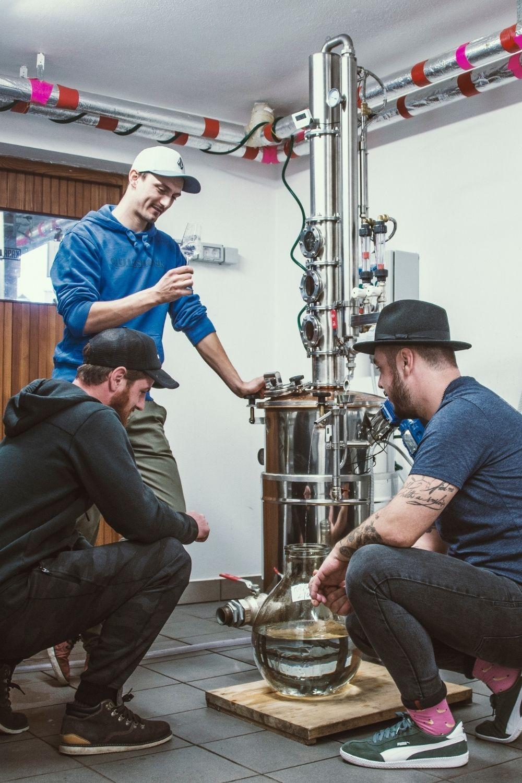 Three craft distillers from Karakter Distillery discussing what is craft gin, next to their small batch column still.