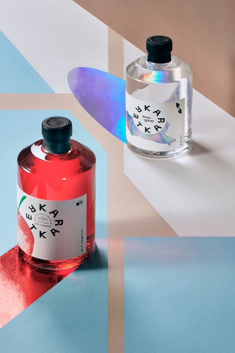 Karakter Distillery's Craft gin bottles on display. The new label reflecting rainbow colours nicely captures Imagine dry gin's artistic flavour. The cherriot bottle is represented with a vivid red colour caused by the finest wild cherries.