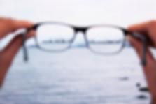 person holding eyeglasses_edited.jpg