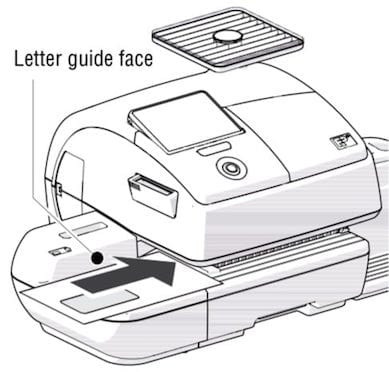 Insert letters into the digital franking machine using the feeder