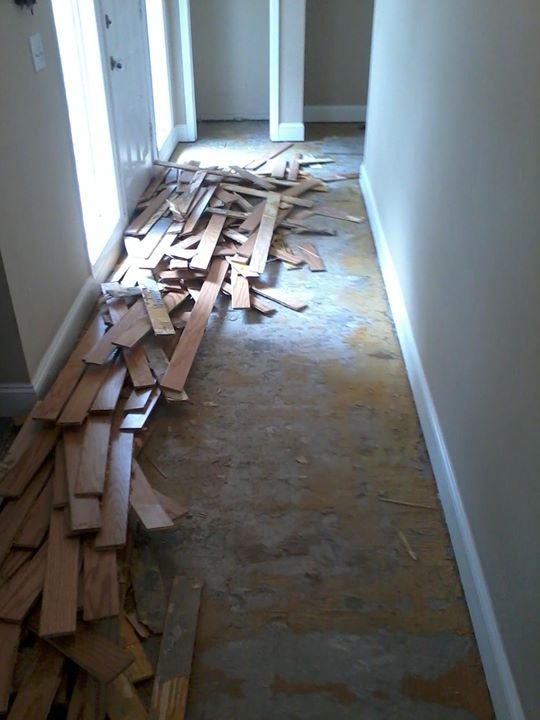 Demo Of Damaged Wood Flooring