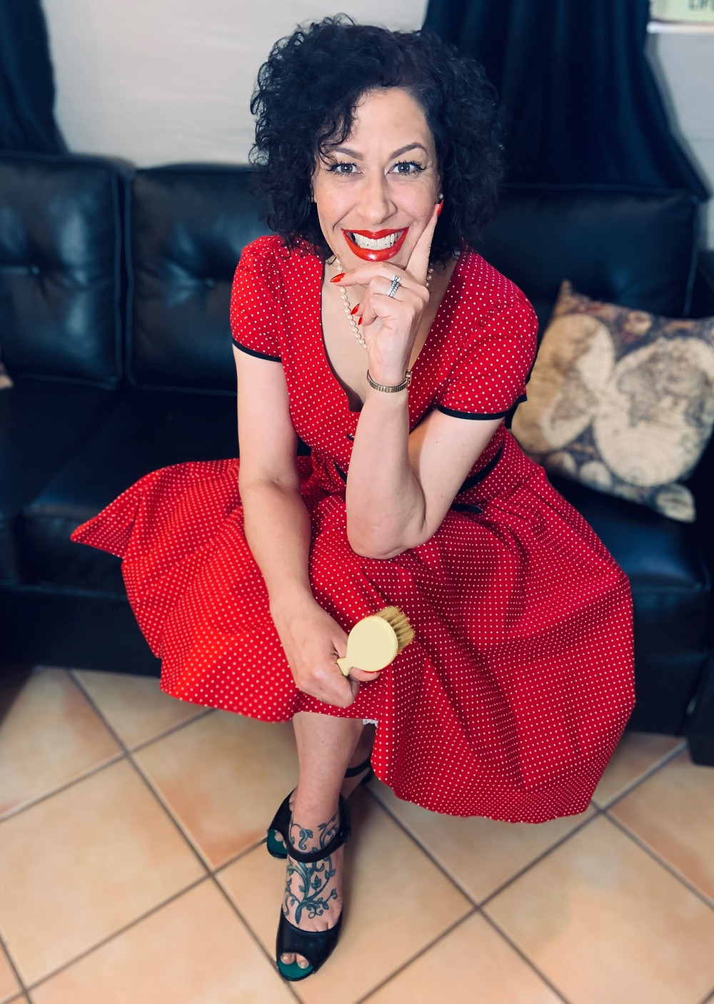 From a recent 1950's themed photo shoot, Miss Chris is seen here with her Bakelite hairbrush and red/white polka dot dress.
