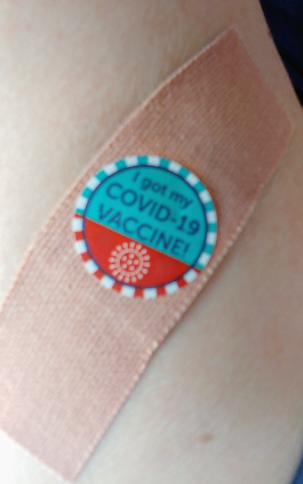 The Arizona vaccine band aid and proof of vaccination sticker