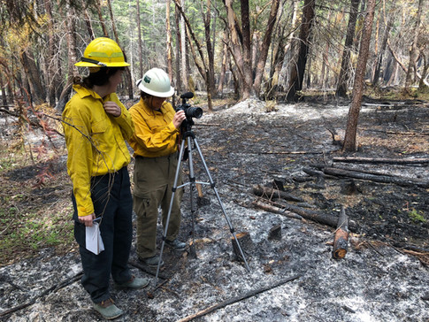 Sierra Webster and Delaney Young reporting on prescribed fire for OR Magazine, photo by Whitney Calvin (OR Magazine)