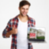 caucasion male holding laptop with home for sale