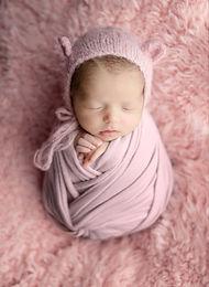 Newborn baby in pink Joanna Komorek Phot