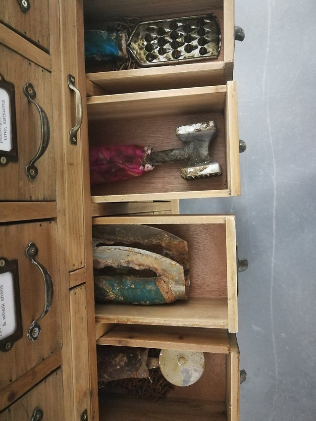 Catalogued weapons in cabinet drawers